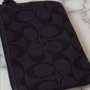 Small black coach wristlet, signature fabric
